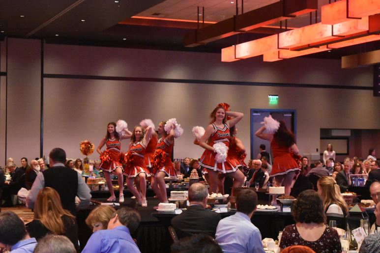 Snohomish High School Cheerleaders perform prior to the start of the auction