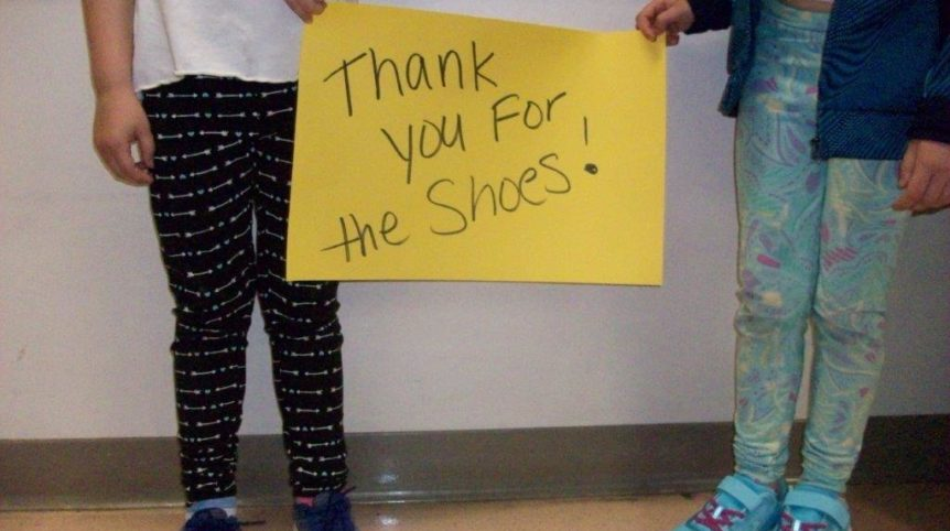 Hansen Shoe Fund student with shoes